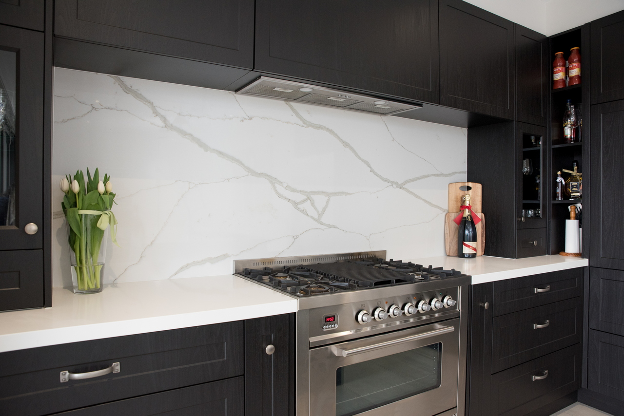 Black and white themed kitchen with marble splashback